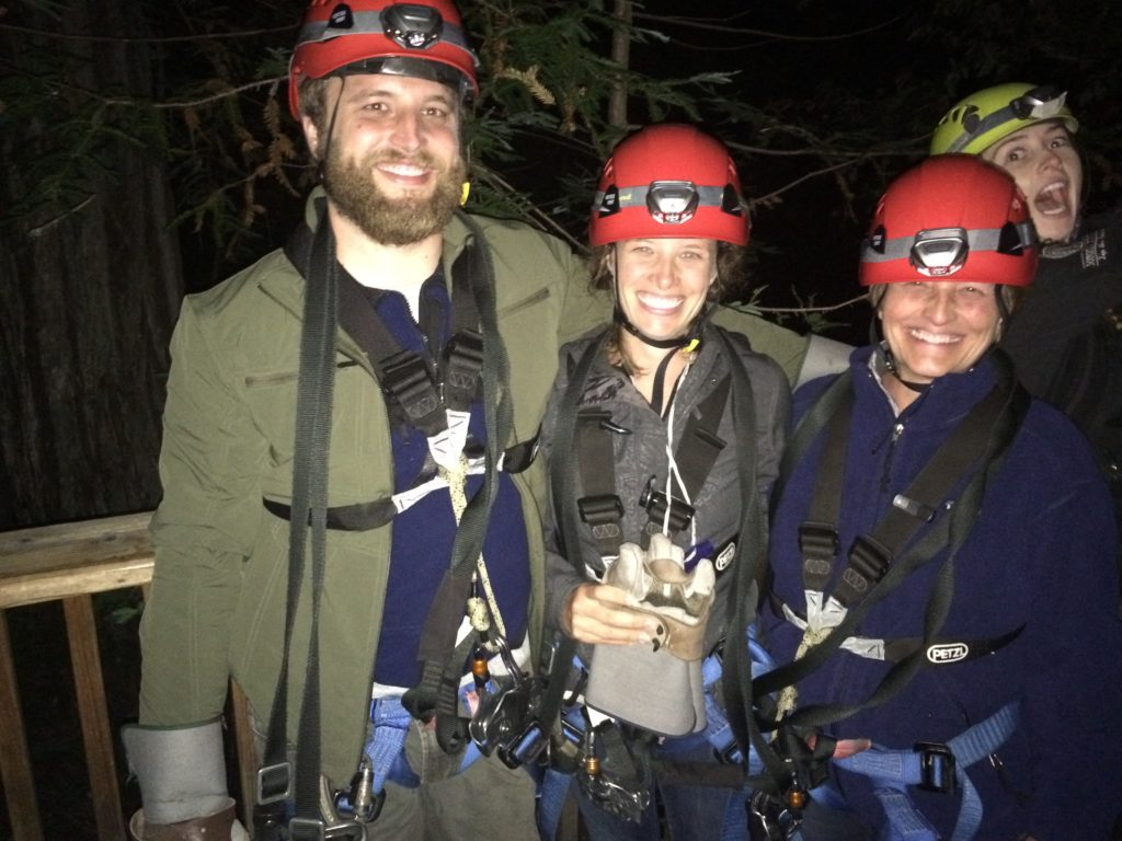 Deborah and Nicole with their guide for nighttime ziplining