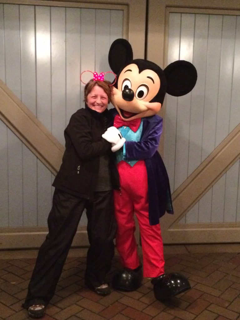 Tremendously Lucky Deborah Myers hugging Mickey Mouse at Disneyland