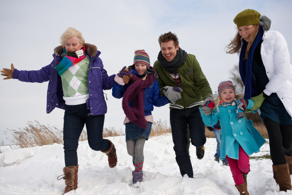Happy multi-generational family in the snow
